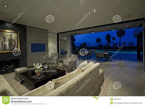 Living Room Pool View Modern Living Room With View Of Patio Stock Photo Image