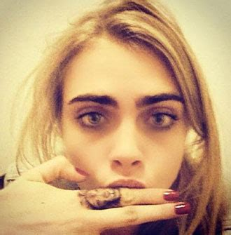 cara delevingne finger tattoo with finger