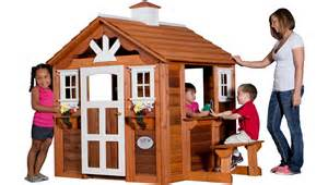 summer cottage playhouse with the look of a country home