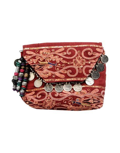 St Lingxi Batik Maroon Kamboja antik batik handbag in maroon lyst