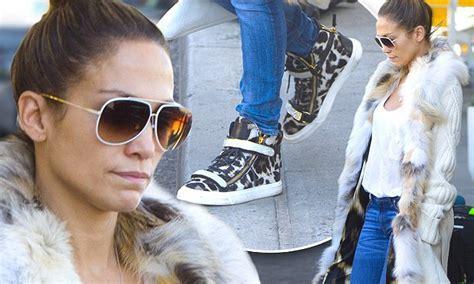 Jennifer Lopez jets into JFK in matching leopard print