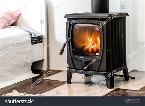 bedroom wood stove wood burning stove in bedroom stock photo 222253783