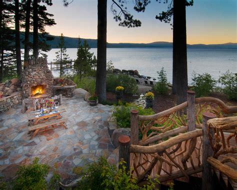 backyard patio design ideas ward log homes lakeside patio with fireplace traditional patio