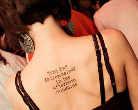 spine tattoos 45 themes and placement ideas with pictures 41 upper back quote tattoos