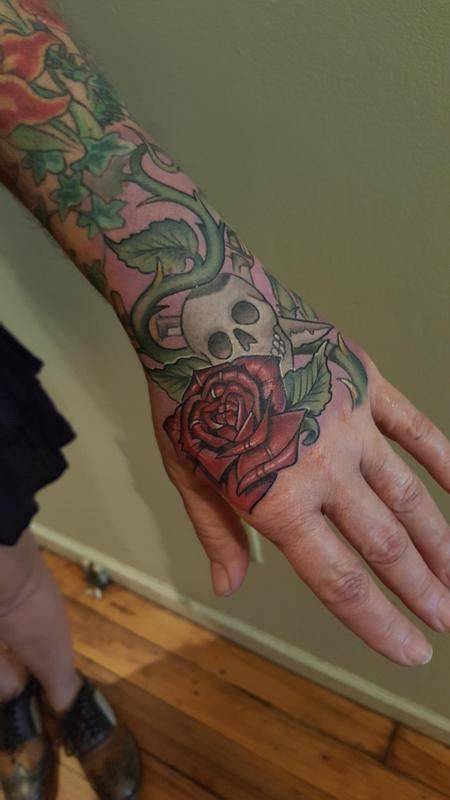 tattoo hand jammer jolly roger hand jammer by mark tousignant tattoonow