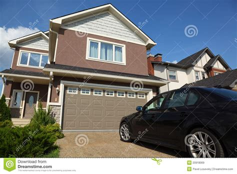 Cottage Cars by Car Near Garage Of New Two Storied Cottage Stock Image