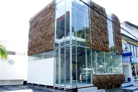 rec architects build a grass glass modern building in