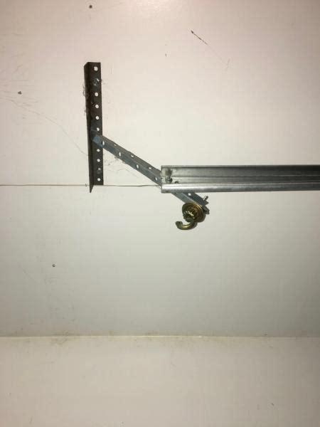 Garage Door Hanging Brackets Garage Door Track Hangers Location Doityourself Community Forums