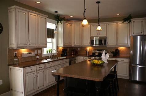maple glazed kitchen cabinets with black painted island pin by leslie rozum on kitchen stuff pinterest