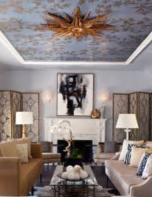 gold leafed starburst mirror on the ceiling steals the