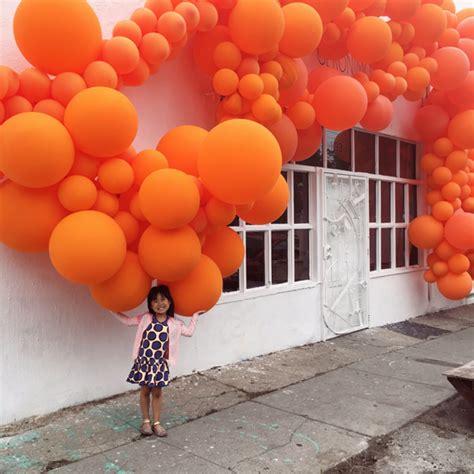 up a balloon with orange orange balloons installation by jihan zencirli of