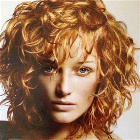 swoop bangs with short curly hair medium length shagged out curly hairstyle without the