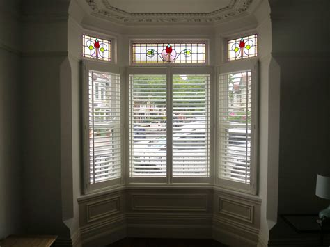 bow windows bookshop cafe style shutters fitted in southsea portsmouth shuttersouth