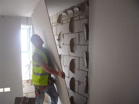 plastering basement walls how to plaster board a wall using the dot dab system drylining dabbing drywall contractors