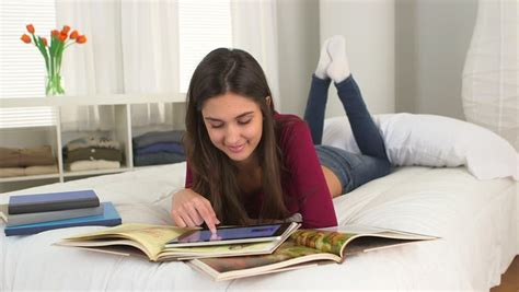 studying in bed young caucasian student studying on her bed stock footage