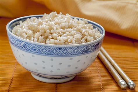 brown rice pattern brown rice in blue and white rice pattern bowl stock photo