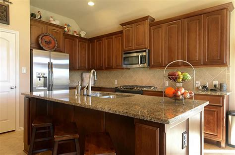 what goes where in kitchen cabinets countertop and backsplash that goes with medium wood