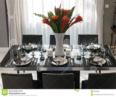 contemporary setting dining table with elegant table setting stock image
