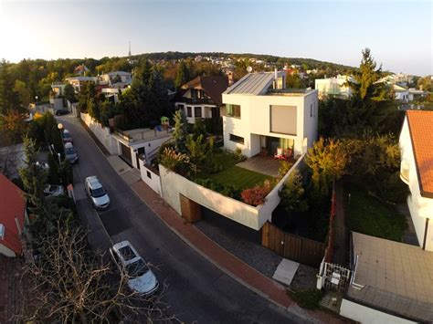 House On Top Of Garage by Modern House With Garden On Top Of The Garage Family