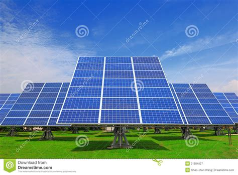 solar panel with green grass and beautiful blue sk royalty