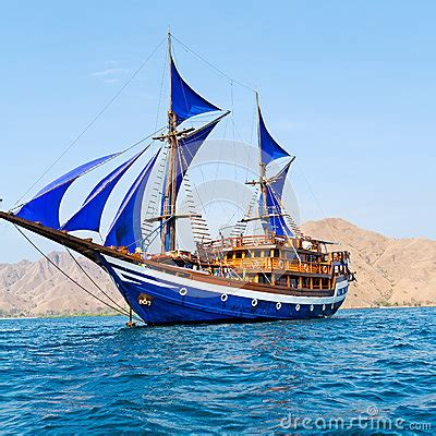 toy boat sails to norway vintage wooden ship with blue sails stock photo image
