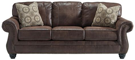 Faux Leather Sofa With Rolled Arms And Nailhead Trim By Leather Sofa Nailhead