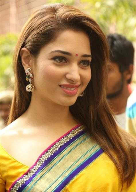 bollywood heroines romantic pics tamanna launches at secunderabad manepally jewellers in