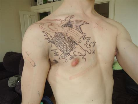 chest tattoo reddit outline of my first tattoo koi fish on chest designed