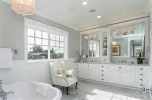 And vanity lighting in white marble master bathroom craftsman bathroom