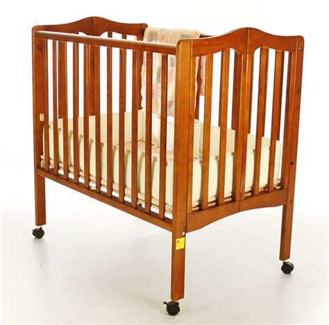 Baby Portable Cribs On Me 2 In 1 Lightweight Portable Folding Crib Pecan Baby Baby Furniture Cribs