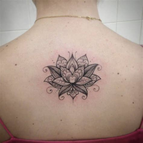 small upper back tattoos small back of a lotus flower by