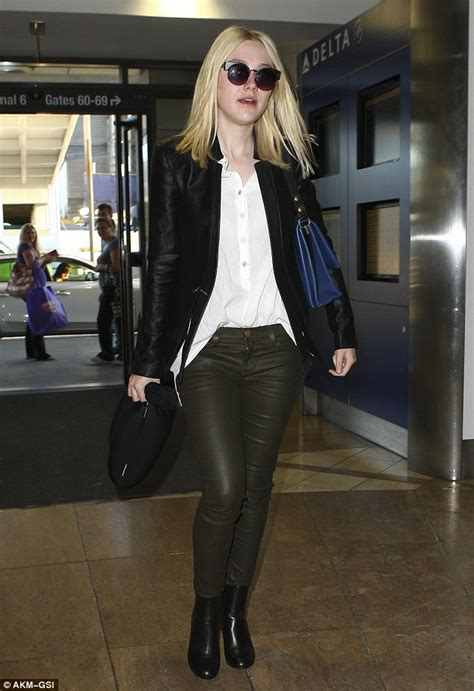 Leather Olive Intl dakota fanning sports a polished look in leather trousers