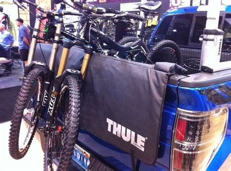 Tailgate Bike Mat thule debuts aeroblade roof bars curved suspended hitch