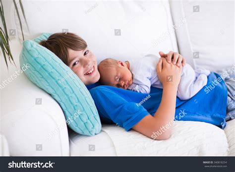 sleeping with baby on couch happy laughing boy holding his sleeping stock photo