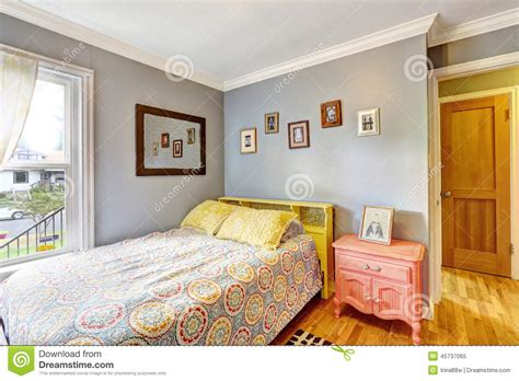 simple bedroom with light blue walls stock photo image