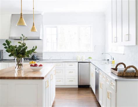 white cabinets with gold hardware trending gold hardware in your kitchen the modern savvy