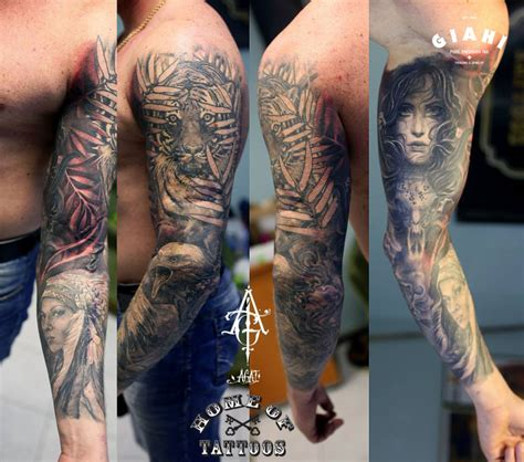 tiger in leaves and graphic tattoo sleeve by agat