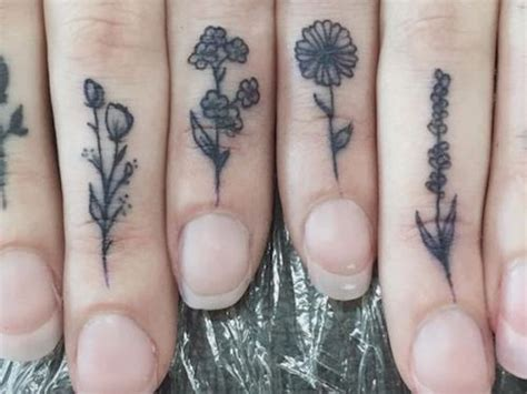 tattoo flower finger 26 tiny floral tattoos that are too pretty for words