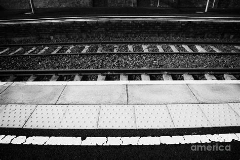 warning line and textured contoured tiles railway station platform and track northern ireland