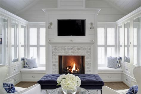 seating in front of fireplace glass front cabinets cottage living room h2 design and build