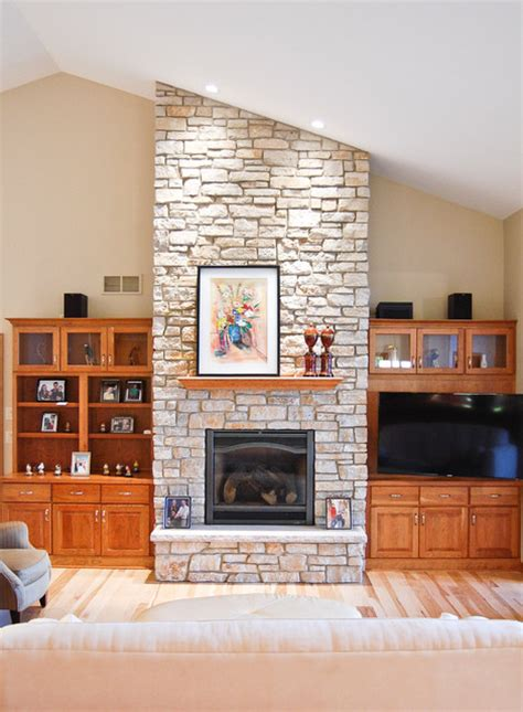great room  stone fireplace  ceiling traditional