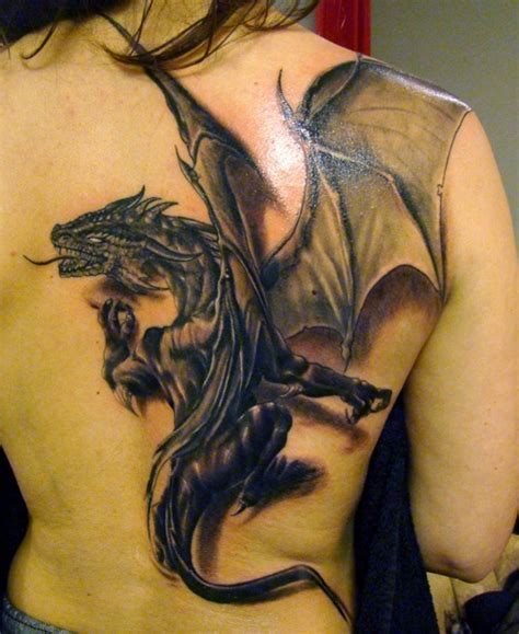 Tattoo Dragon Real | tattoo of a black dragon on back which looks like real