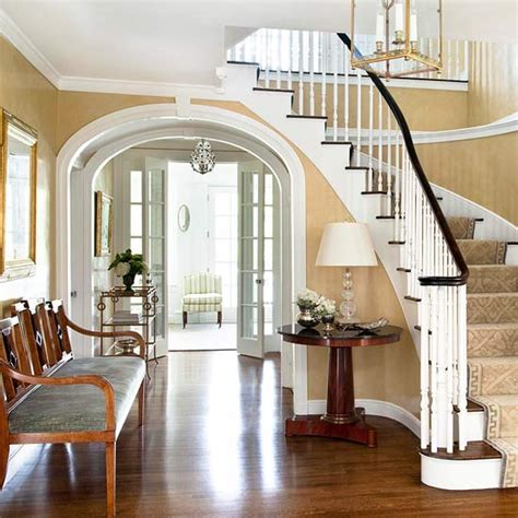 Decorating Ideas For Foyers With Staircases Traditional Foyer With Curved Staircase And Arched