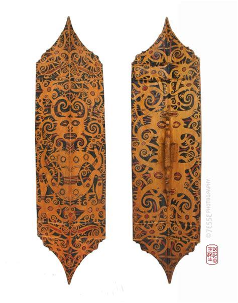 budaya tattoo indonesia dayak shield back front view origin indonesia