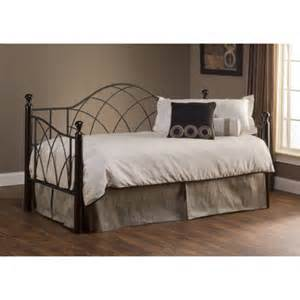Furniture iron day bed with trundle using striped bedding placed on