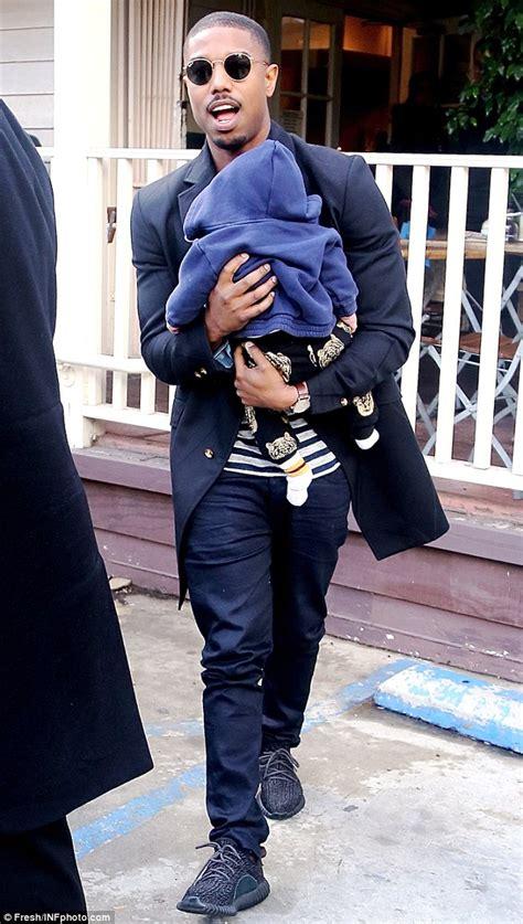 creeds michael  jordan cuddles  friends baby  los