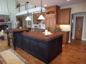 black kitchen island with butcher block top kitchen