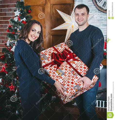 big box new year happy family near new year tree stock photo image 63981230