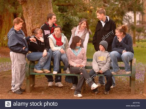 park bench group a group of teenage boys and girls sitting on a park bench
