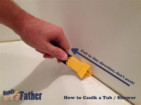 removing an old bathtub a caulk removing tool handy father